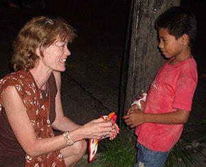 Philippines 2012 Lee speaks to child