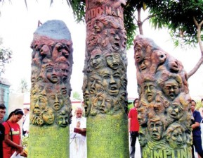 three sculptured totems in honor of the disappeared