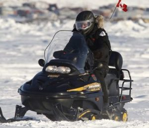 Steve on noisy non-stealth snowmobile.
