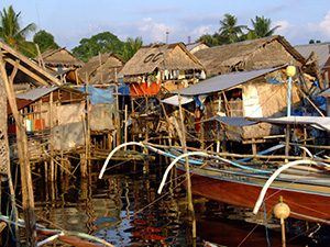 Precarious housing homes on stilts and boats