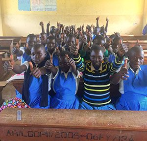 Ugandan school girls give thumbs up