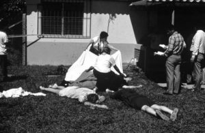 Covering the bodies of the two women killed along with the six Jesuit priests