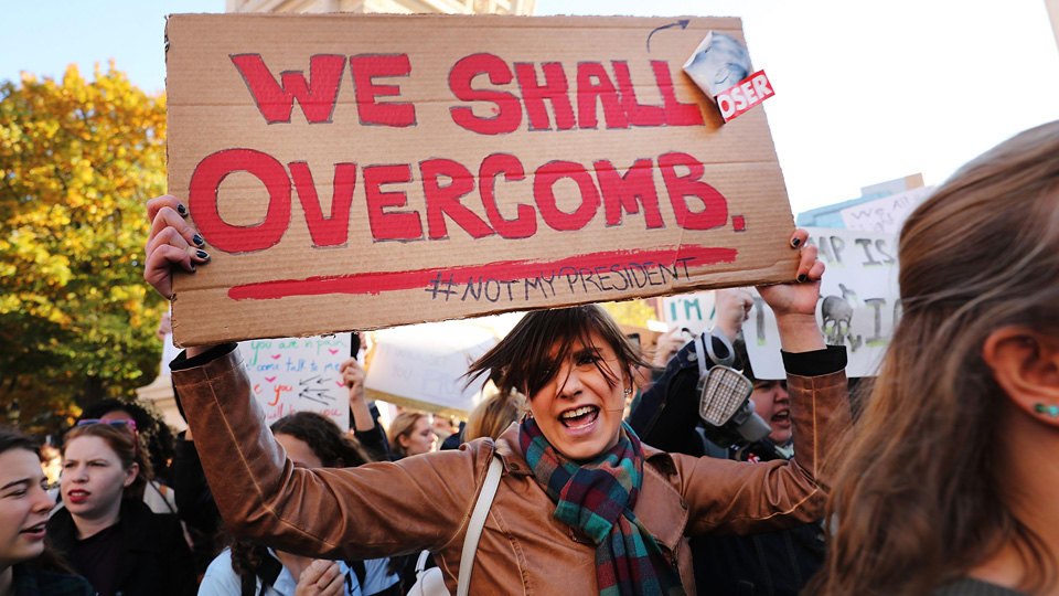 Womens March sign: We shall overcomb