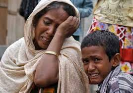 Woman and boy crying over violence in their village