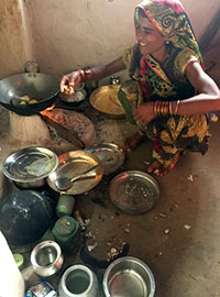 Village women prepares a meal.