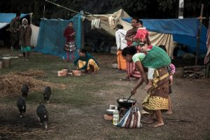women in camp making meal